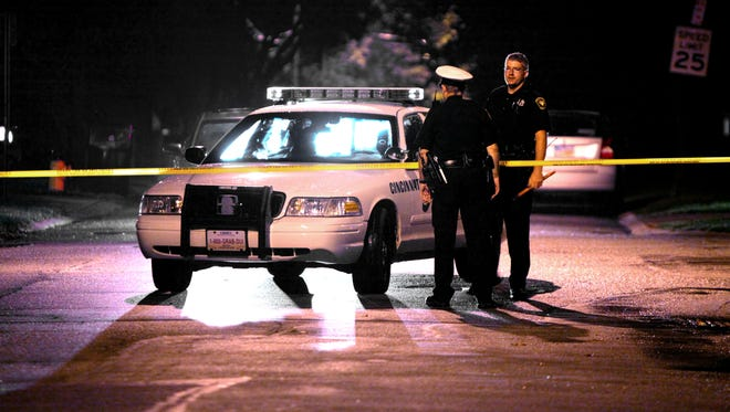 Police investigate a shooting in Roselawn Monday night. A man was shot in the nose, but he is expected to survive.