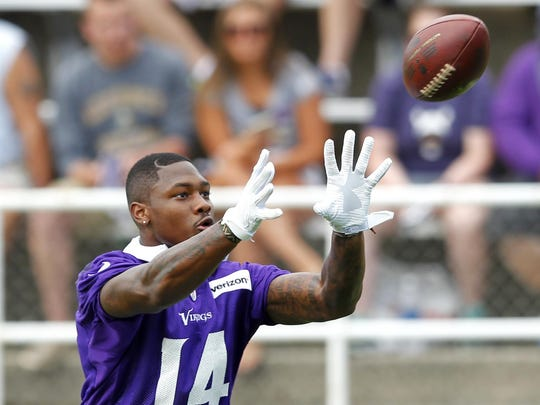 Minnesota Vikings wide receiver Stefon Diggs (14) makes a catch during the first day of training camp Friday at Minnesota State University in Mankato.
