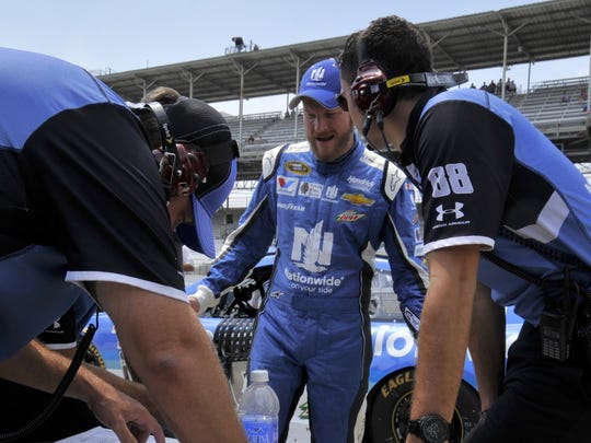 On Saturday Dale Earnhardt Jr. discusses strategy with his crew prior to his final round of qualifications for Sunday's Brickyard 400 at the Indianapolis Motor Speedway.