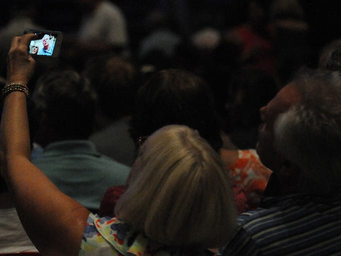 Fans take a selfie at the James Taylor concert at the