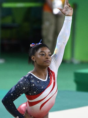 Simone Biles is favored to win the Olympics all-around Thursday.
