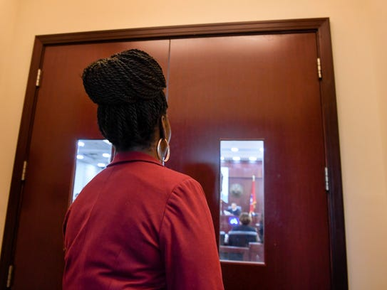 Laterra Logue stands outside the courtroom Nov. 8,