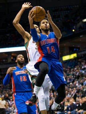 Detroit Pistons guard D.J. Augustin (14) drives for a shot during the first quarter against the Milwaukee Bucks at BMO Harris Bradley Center.