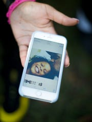 Sade Harris, mother of Timea Batts, shows a picture