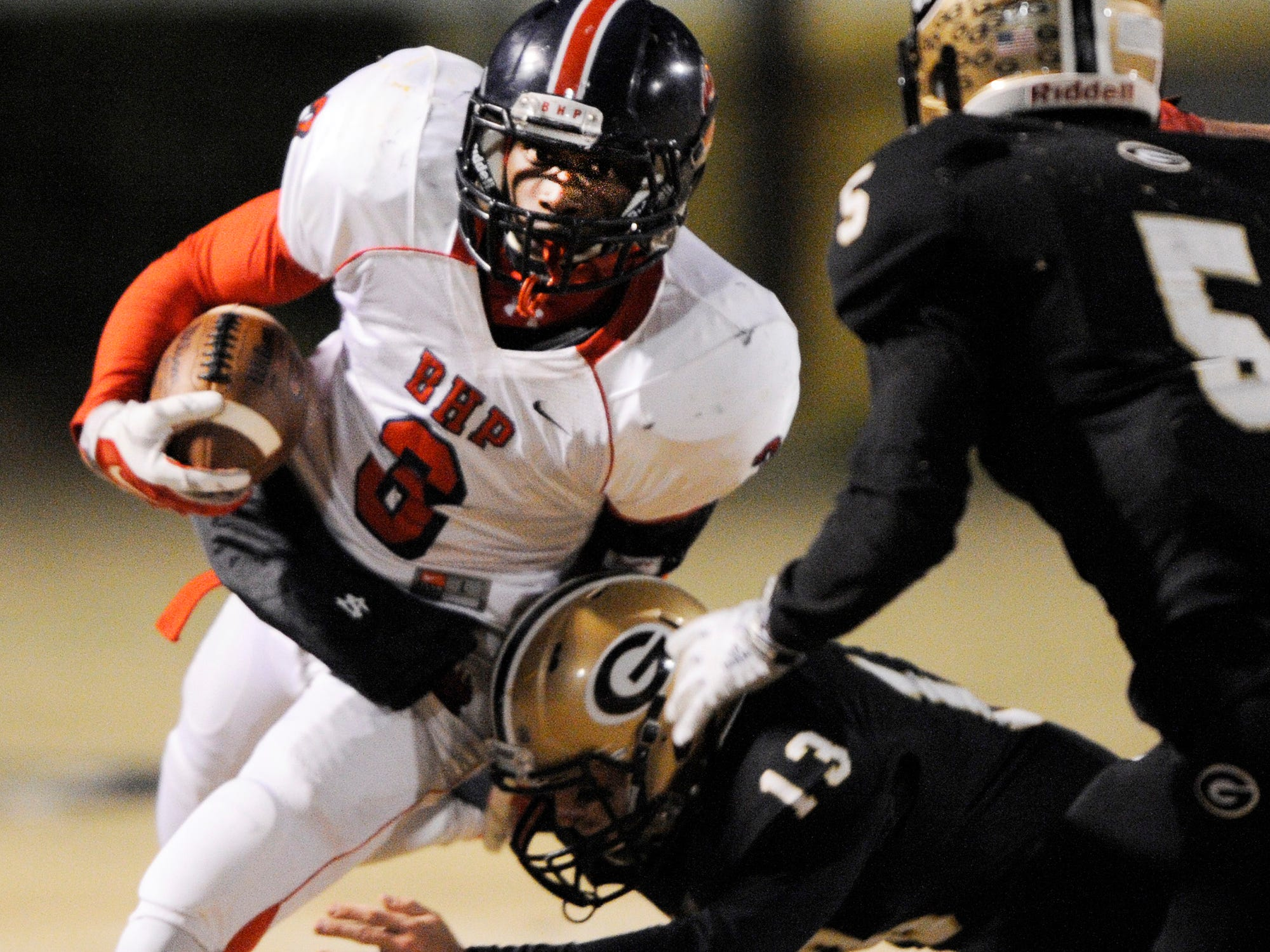 B-HP's Jawunn Abney (3) is caught by Greer's Jackson Tipton.