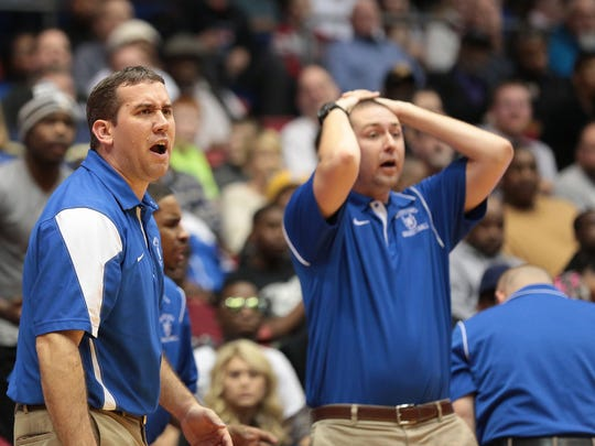 Wyoming head coach Matt Rooks and the bench react after a referee's call during the Cowboys' 37-49 loss to Thurgood Marshall Friday, March 7, 2014. (Tony Tribble for the Enquirer)