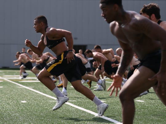 Shown in July, then-sophomore tight end Noah Fant (87) wears a GPS receiver to track his movements during a practice.