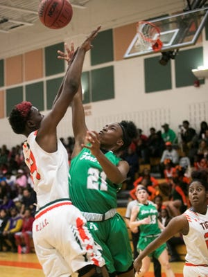 Dunbar's Ja'Miah Bland tries to block a shot by Samara Spencer of Fort Myers on Friday, Jan. 19, 2018, at Dunbar High School in Fort Myers.
