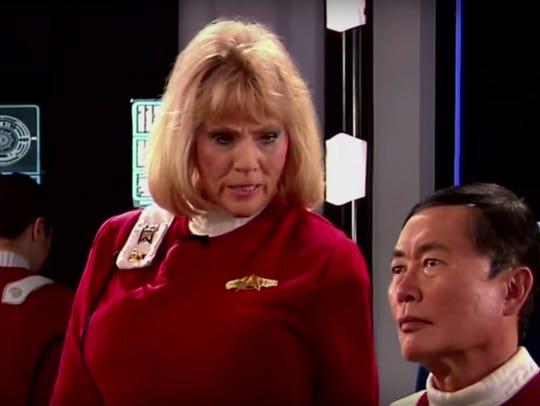 Grace Lee Whitney as Janice Rand and George Takei as