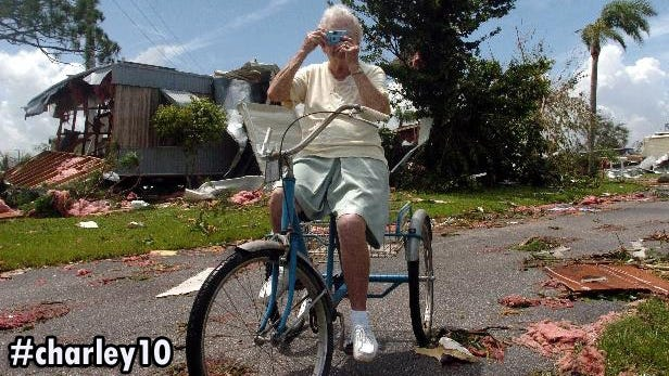 Marion Lindley, 87, sits atop her tricycle bike and takes a picture of the devastation caused by Hurricane Charley in what used to be the Parkhill Mobile Home Park where she retired to about 12 years ago