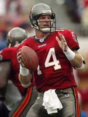 Quarterback Brad Johnson of the Tampa Bay Buccaneers gets ready to pass against the Houston Texans December 14, 2003 at Raymond James Stadium in Tampa, Florida.