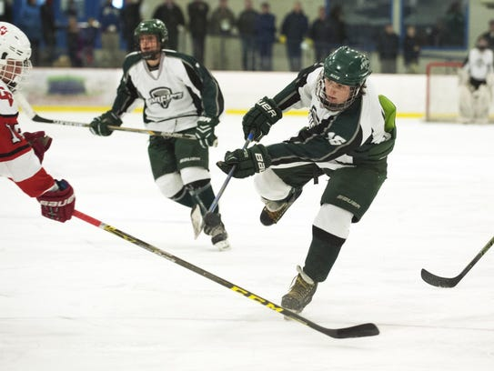 Rice's Jacob Matosky (15) takes a shot during the boys
