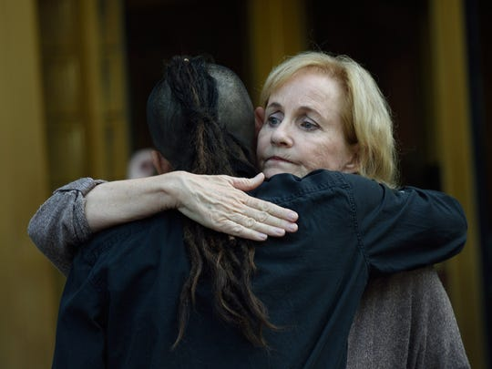 Lyn Ulbricht, mother of Silk Road founder Ross Ulbricht, gets a hug from a friend outside the Federal Courthouse May 29, 2015 in New York.