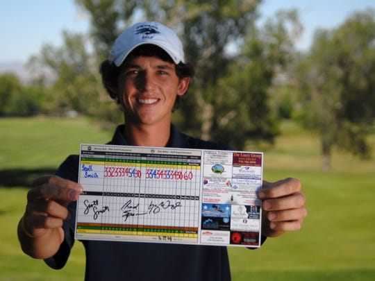 Fallon's Scott Smith holds up his score card from his course-record breaking round of 60 at Washoe Golf Course in 2009. Smith will be playing in the Reno Open next month, hoping to qualify for a spot in the Barracuda Championship.