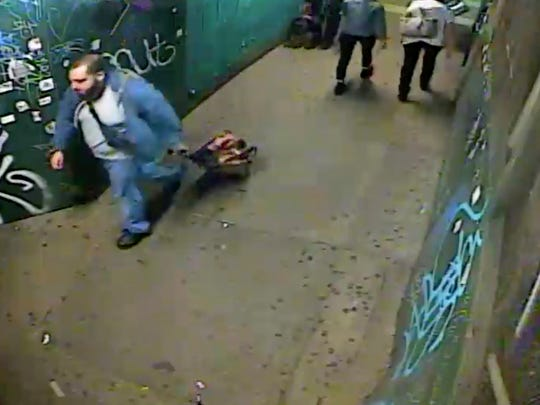 In this image taken from a Sept. 17, 2016, surveillance video and provided by the United States Attorney's Office, Ahmad Khan Rahimi pulls a suitcase believed by prosecutors to be containing a pressure cooker bomb in New York. The trove of digital evidence in Rahimi's ongoing federal trial is meant to provide airtight proof he was behind a 2016 attack, but it also dramatically demonstrates the growing omnipresence of security cameras. (Courtesy of the United States Attorney's Office via AP)