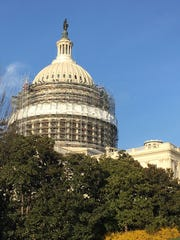Scaffolding surrounds the U.S. Capitol dome as it undergoes