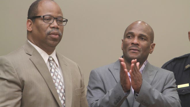 Charles Pierre, right, and his attorney, Van Henry White, react to the verdict on Thursday.