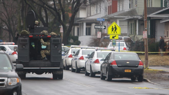 Rochester police negotiate with a man to leave a residence on Driving Park Avenue on Thursday. After roughly three hours, he left without incident and was being questioned.
