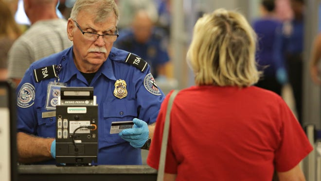John Samora/The Republic  TSA officer John Balsis checks the identification of travelers entering  Sky Harbor International Airport in Phoenix. John Samora/ The Republic TSA officer John Balsis check identifications of travelers entering the D concourse of terminal 4 at Sky Harbor as seen in Phoenix. TSA officer John Balsis check ID's of travelers entering the D concourse of terminal 4 at Sky Harbor as seen in Phoenix on Mar., 18, 2015