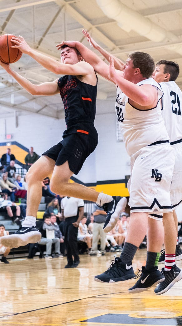 Rosman's Hooper Thomas is fouled on by North Buncombe's