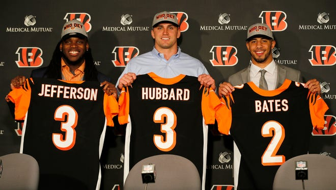 New Cincinnati Bengals draft picks (left to right) Malik Jefferson, Sam Hubbard and Jessie Bates III pose with their draft jerseys before a press conference at Paul Brown Stadium in downtown Cincinnati on Saturday, April 28, 2018.