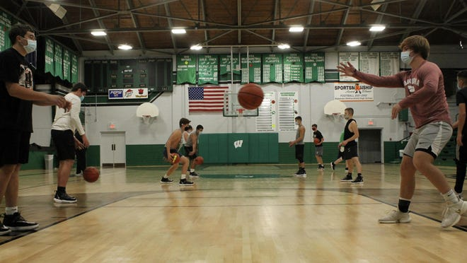 The Wethersfield boys basketball team is engaged in a passing drill on Wednesday at the high school's main gymnasium.