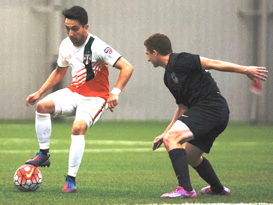 The Bucks' Goncalo Soares (left) keeps the ball away from a Derby City Rovers defender in Saturday's 1-0 win.