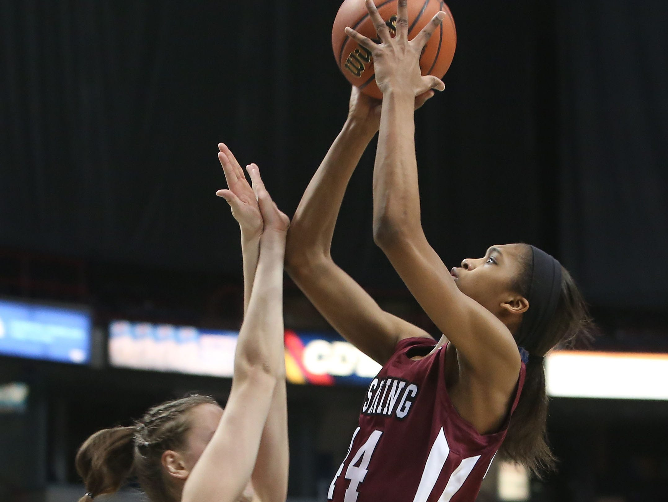 Ossining's Aubrey Griffin (44) goes up for a shot in front of Long Island Lutheran's Sarah Mortensen (5) during the girls Class A final of the New York State Federation Tournament of Champions at the Times Union Center in Albany March 18, 2016.