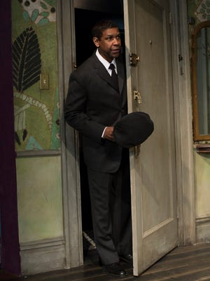 Denzel Washington makes an entrance at the Ethel Barrymore Theatre in New York.