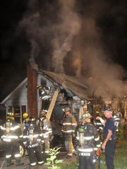 Brewster and Croton Falls firefighters work at the