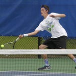 Covington Catholic's Austin Hussey won his fourth straight regional tennis title on Tuesday.