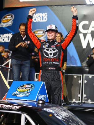 NASCAR Camping World Truck Series driver Erik Jones celebrates after clinching the 2015 championship at the Ford Ecoboost 200 at Homestead-Miami Speedway Friday.
