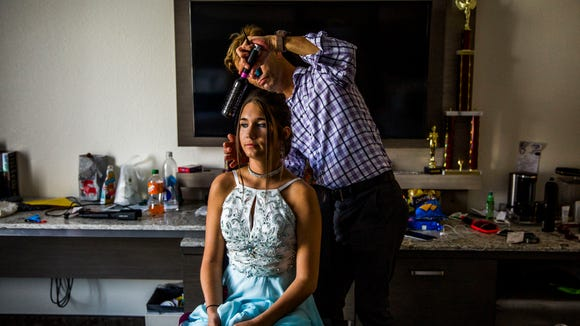 Palmetto Ridge High junior Kaitlyn Sokolich has her hair done by hair stylist Wil Barnes before competing in the junior teen division of the Miss Teen national pageant at the Rosen Centre Hotel in Orlando on Saturday, Dec. 16, 2017.
