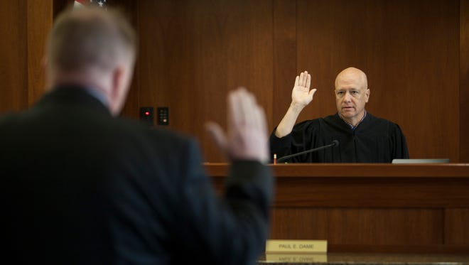 Judge Paul Dame swears in Michael T. Truebenbach, an explosives expert from the Federal Bureau of Investigation, during the case of a juvenile accused of bringing a bomb to Pine View High School Friday, May 11, 2018.