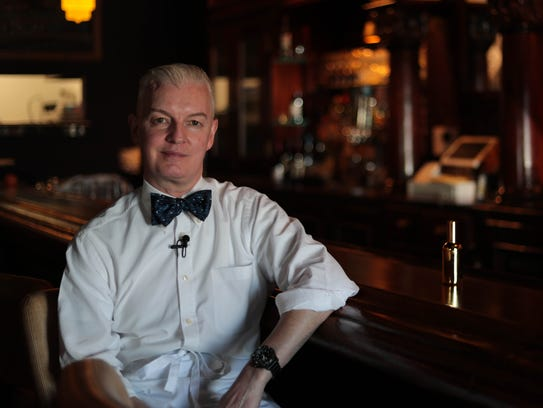 Paul O'Halloran, owner of Paul Bar, poses for a photo