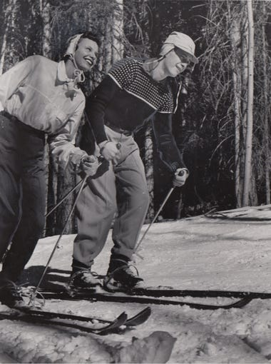 A couple enjoys skiing at Arizona Snowbowl near Flagstaff in this undated photo.