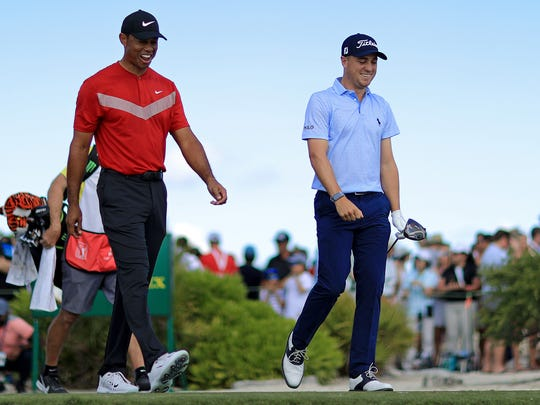 NASSAU, BAHAMAS - DECEMBER 07: Tiger Woods and Justin Thomas of the United States walk off the first hole during the final round of the Hero World Challenge at Albany on December 07, 2019 in Nassau, Bahamas. (Photo by Mike Ehrmann/Getty Images)