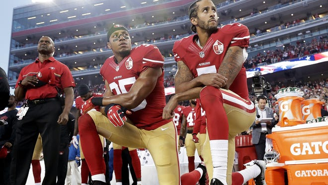 San Francisco 49ers safety Eric Reid (35) and quarterback Colin Kaepernick kneel during the national anthem before a game in September 2016 against the Los Angeles Rams in Santa Clara, Calif.