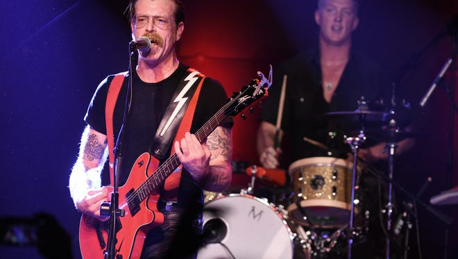 Musicians Jesse Hughes (left) and Josh Homme of Eagles of Death Metal perform at the Teragram Ballroom on October 19, 2015, in Los Angeles.