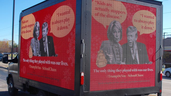 A mobile digital billboard, sponsored by the nonprofit Neighbors for Public Schools, criticizing Secretary of Education Betsy DeVos and President Donald Trump, swung through Holland Wednesday, Oct. 28.