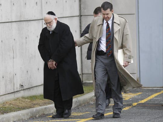 Town of Ramapo Councilman Samuel Tress is led out of the Rockland County Courthouse in New City, to be arraigned in court in the Village of Airmont on charges of filing a false instrument and official misconduct on Thursday.