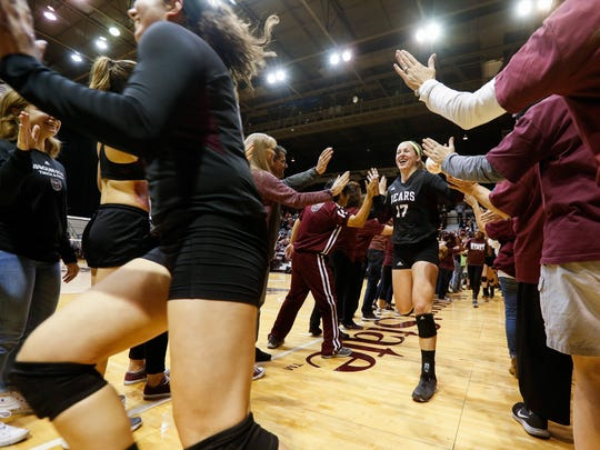 Lily Johnson (17) high fives fans as the Missouri State