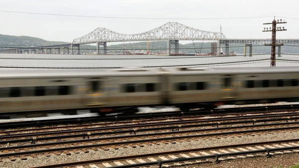 A Metro-North train streaks along the Hudson River