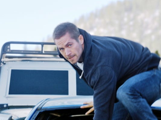 "This photo provided by Universal Pictures shows, Paul Walker as Brian, in a scene from ""Furious 7.""  (AP Photo/Universal Pictures)"