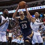New Orleans Pelicans power forward Anthony Davis (23) drives to the basket past Dallas Mavericks.