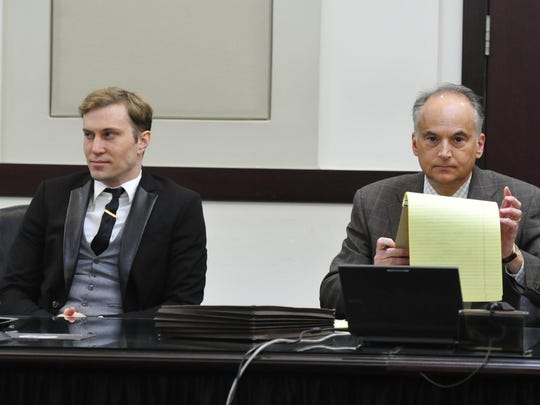 """Mark """"Chris"""" Sevier listens with lawyer Peter Strianse during his arraignment hearing April 23, 2014. Sevier is accused of stalking country music singer John Rich."""