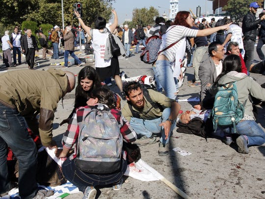People help victims following an explosion at the main train station in Turkey's capital Ankara, on Oct. 10, 2015.