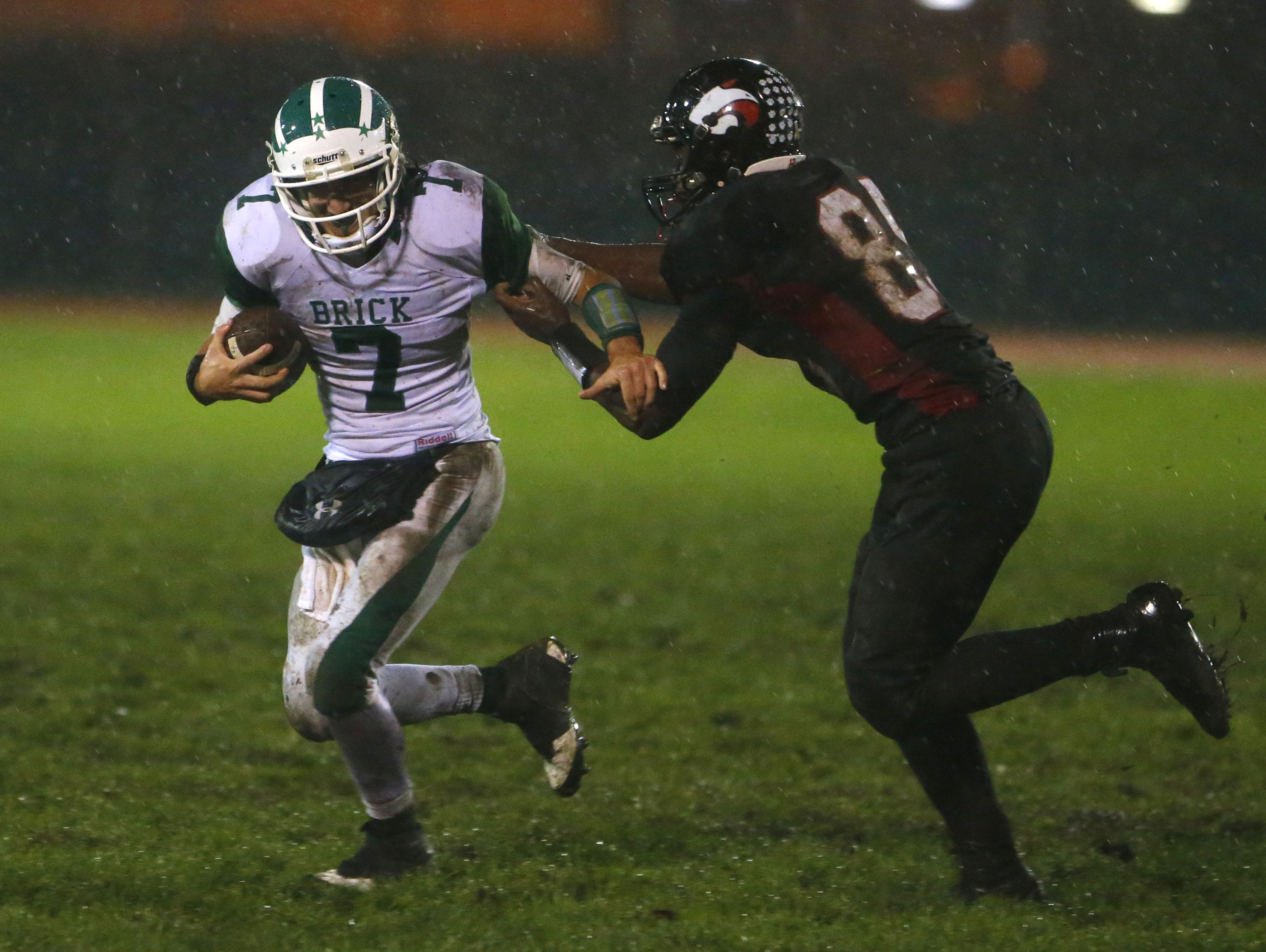 Brick running back Ja'Sir Taylor (white uniform No. 7), shown being pursued by Jackson Memorial defensive end Tyler Towns, and Jackson Memorial will meet Friday night in an NJSIAA Central Group IV quarterfinal