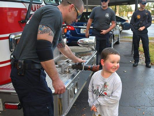 Firefighters visit AJ Demarest