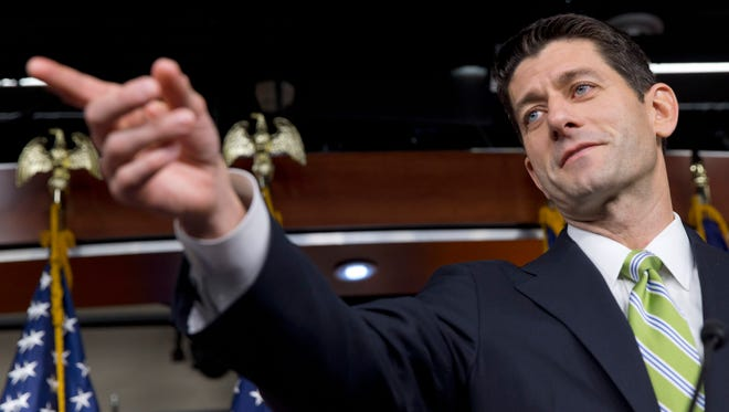 In this Nov. 19, 2015 photo, House Speaker Paul Ryan of Wis. calls on a reporter during a news briefing on Capitol Hill in Washington.  Lawmakers return to Washington for an end-of-session sprint to avert a government shutdown, finally pass a long-term highway funding bill, and clear away unfinished business like renewing tax breaks for individuals and business. The new two or three weeks will be a big test for new Speaker Paul Ryan, who has to balance the demands of conservatives with the need to get Obama to sign must-do bills.  (AP Photo/Jacquelyn Martin)